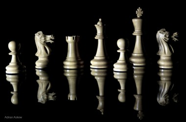 reflecting white chess pieces